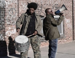 questlove and black thought with megaphone